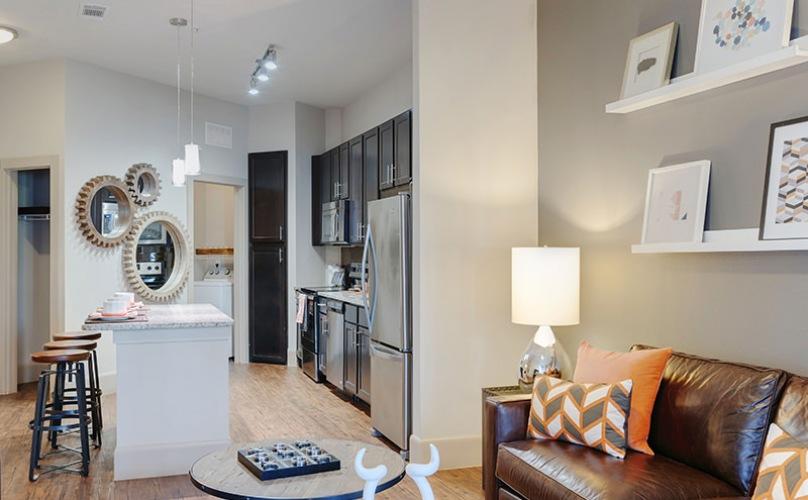 living room with kitchen adjacent